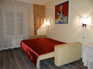 A bed or beds in a room at Art Apartment