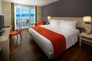 A bed or beds in a room at Amari Phuket