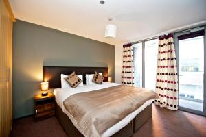 A bed or beds in a room at Staycity Aparthotels Millennium Walk