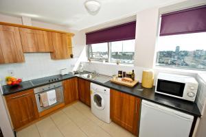 A kitchen or kitchenette at Staycity Aparthotels Millennium Walk