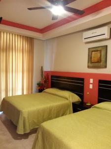 A bed or beds in a room at Hotel y Suites Los Encantos