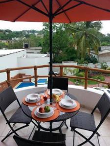 A view of the pool at Hotel y Suites Los Encantos or nearby