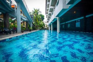 The swimming pool at or near Melasti Kuta Bungalows & Spa