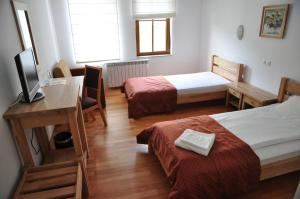 A bed or beds in a room at Hotel Black Stork