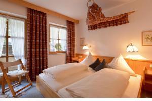 Ein Bett oder Betten in einem Zimmer der Unterkunft Haus Gaisberger