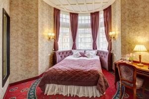 Hotel Atlas Deluxe tesisinde bir odada yatak veya yataklar