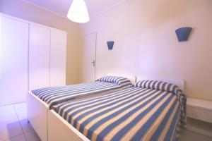 A bed or beds in a room at TH Ortano - Ortano Mare Residence