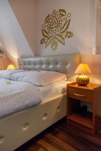 Łóżko lub łóżka w pokoju w obiekcie Willa Regina