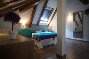 Cama o camas de una habitación en Hotel Rural Auñamendi