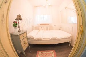 A bed or beds in a room at Gorod Patriarshie Hostel
