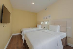 Кровать или кровати в номере Dom Hotel Apart