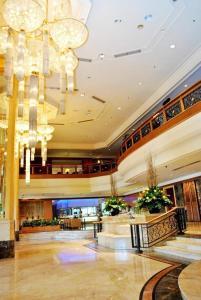 The lobby or reception area at Ramada Plaza by Wyndham Melaka