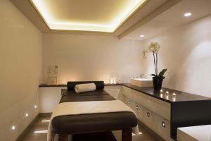 Un ou plusieurs lits dans un hébergement de l'établissement Hotel D - Strasbourg - Room service disponible