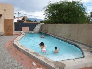 The swimming pool at or near Cabañas Luna y Sol