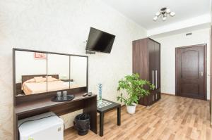 A television and/or entertainment center at Mini Hotel on Saydasheva