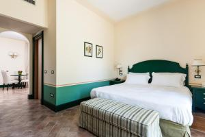 A bed or beds in a room at Alla Corte Delle Terme Resort & Ristorante