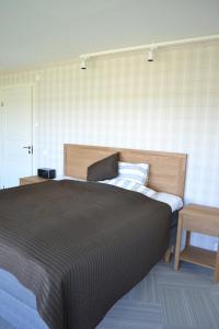 Säng eller sängar i ett rum på Sjöbredareds Gård