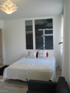 Säng eller sängar i ett rum på Lapland City Centre Apartments