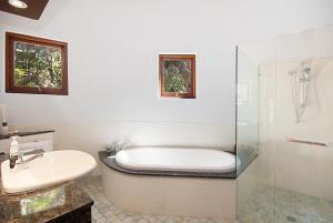 A bathroom at 2/9 Marine Parade, Wategos Beach - Beachbound