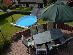 A view of the pool at Pension Haus Wanninger or nearby