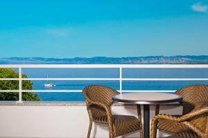 A balcony or terrace at Spa & Wellness Hotel Pinia