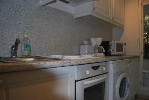 A kitchen or kitchenette at Cannes Republique Two Bedrooms
