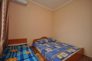 A bed or beds in a room at Morskaya Cherepashka Guest House