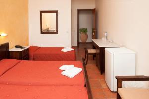 Ein Bett oder Betten in einem Zimmer der Unterkunft Hotel Apollon