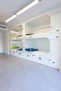 A bunk bed or bunk beds in a room at Dream Cube Hostel