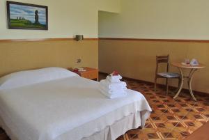 Cama o camas de una habitación en Iorana Isla de Pascua Hotel