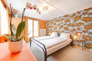 Ein Bett oder Betten in einem Zimmer der Unterkunft Pension Aaron am See