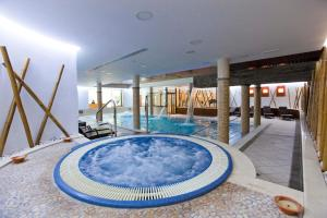 The swimming pool at or near Hospes Palacio de Arenales & Spa