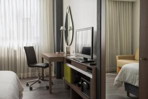 A television and/or entertainment center at Hampton by Hilton Barranquilla