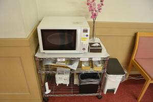 A kitchen or kitchenette at Hotel Ascent Inn Sapporo