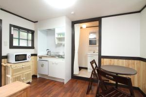 A kitchen or kitchenette at Hotel Morgenrot