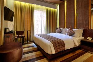 A bed or beds in a room at Mega Boutique Hotel