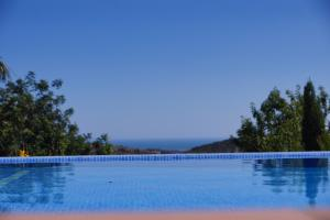 The swimming pool at or close to Casa Mocho Branco