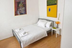 A bed or beds in a room at Apartment Belgrade center