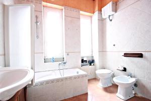 Un baño de Scalini di Trastevere
