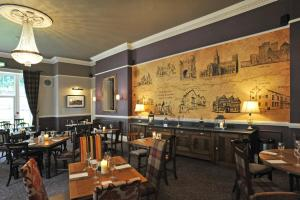 A restaurant or other place to eat at Royal Hotel by Greene King Inns