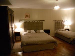 Un ou plusieurs lits dans un hébergement de l'établissement Gîte d'Airaines