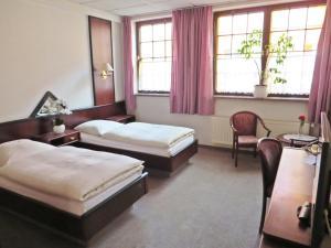 Ein Bett oder Betten in einem Zimmer der Unterkunft Hotel Roseneck