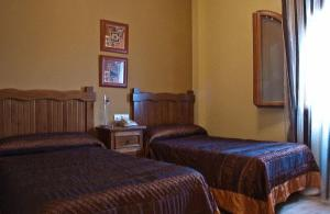 A bed or beds in a room at Hotel Rural Miguel Angel