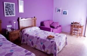 Cama o camas de una habitación en Hotel Rural Miguel Angel