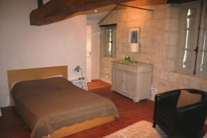 Un ou plusieurs lits dans un hébergement de l'établissement Gite Chateau de Chaintres