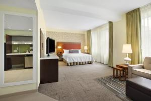 A bed or beds in a room at Home2 Suites by Hilton San Antonio Downtown