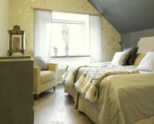 Säng eller sängar i ett rum på Smakrike Krog & Logi