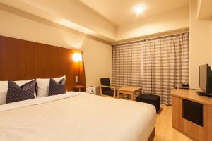 A bed or beds in a room at Sakura Terrace