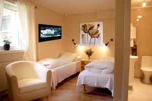 A bed or beds in a room at Tynset Rom & Camping