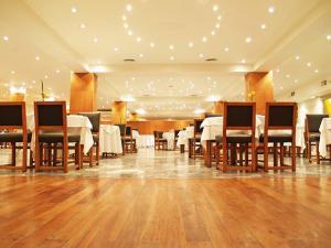 Un restaurant u otro lugar para comer en Gran Hotel Provincial
